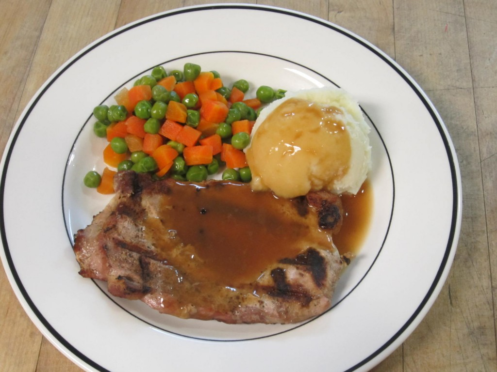 Grilled Pork Chop, Mashed Potatoes & Carrots/Peas